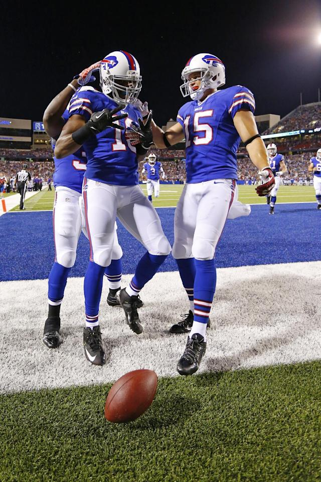 Buffalo Bills' Brad Smith (16) celebrates with teammates Chris Hogan (15) and Zach Brown, left rear, after scoring a touchdown during the second half of an NFL preseason football game against the Minnesota Vikings on Friday, Aug. 16, 2013, in Orchard Park, N.Y. (AP Photo/Bill Wippert)