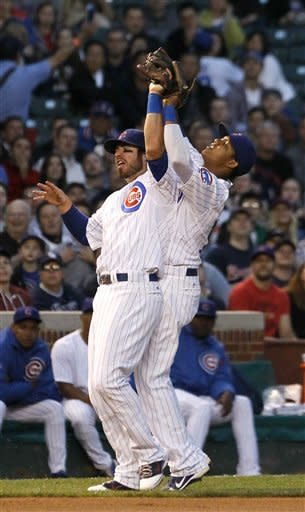 Chicago Cubs third baseman Ian Stewart, left, and shortstop Starlin Castro, go after a pop up by Atlanta Braves' Michael Bourn, during the third inning of a baseball game Tuesday, May 8, 2012, in Chicago. (AP Photo/Charles Rex Arbogast)