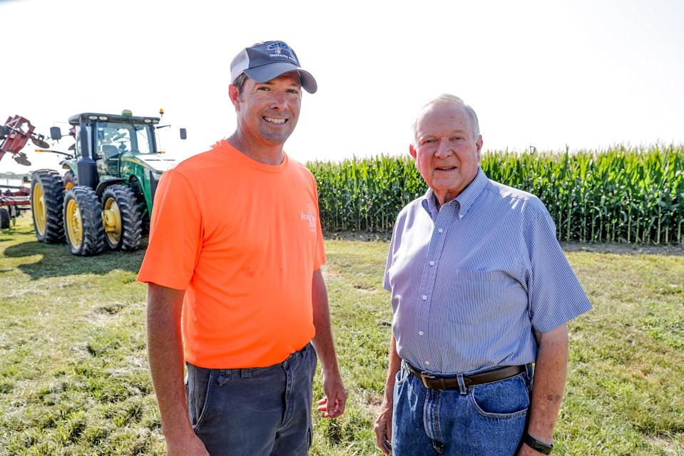Father and son farmers, John Hardin, right, and David Hardin, left, stand on the property of their family farm in Danville Ind., on Wednesday, Aug. 7, 2019. The Hardin's, who own farmland in Hendricks and Putnam counties, raise hogs, corn, soybeans and winter wheat, are affected by escalating tensions in the U.S.-China trade war.