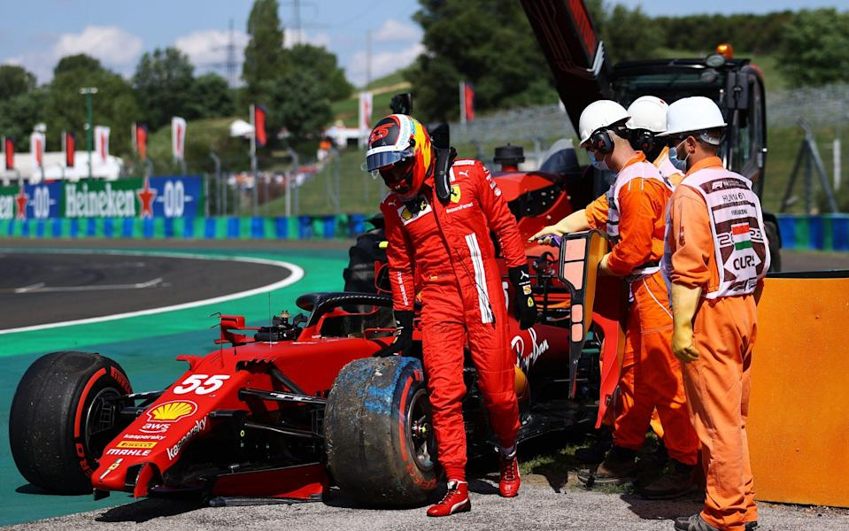Carlos Sainz of Spain driving the (55) Scuderia Ferrari SF21 walks from his car after a crash during qualifying ahead of the F1 Grand Prix of Hungary at Hungaroring on July 31, 2021 in Budapest, Hungar - Bryn Lennon/Getty Images