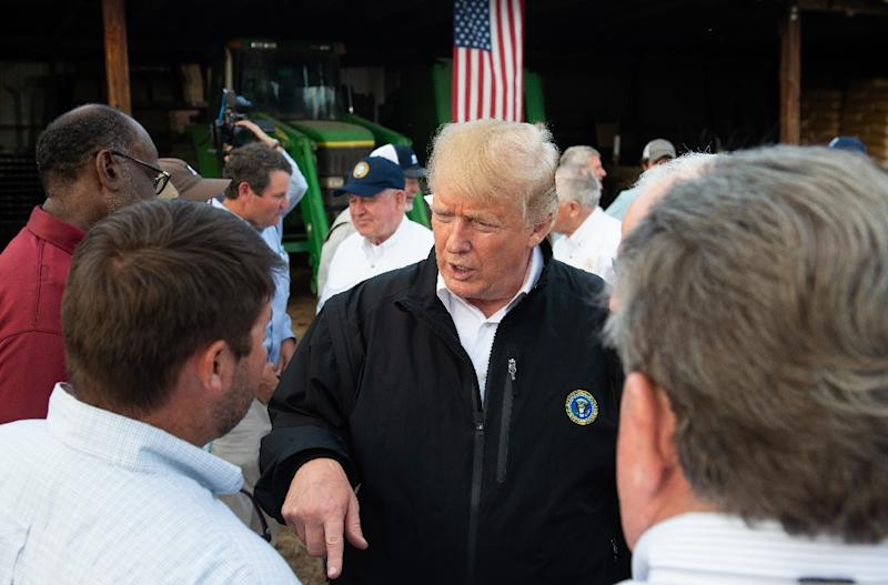 US President Donald Trump meets with farmers impacted by Hurricane Michael at a farm in Macon, Georgia (AFP Photo/SAUL LOEB)