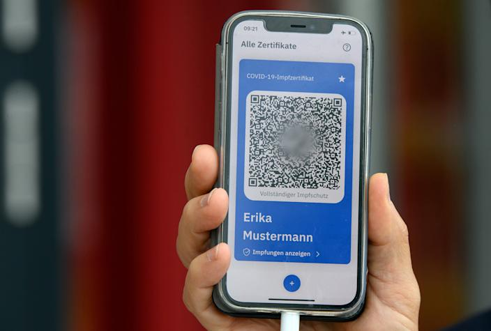 Introducing the new COVID-19 COVPASS digital vaccination passport in Potsdam, Germany on May 27, 2021. Soeren Stache / Pool via REUTERS ATTENTION EDITORS - PARTS OF THE IMAGE HAVE BEEN BLURGED AT SOURCE