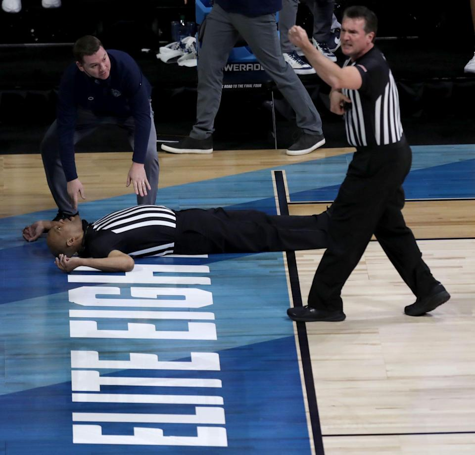 NCAA basketball official Bert Smith lies on the court after collapsing during the Gonzaga-USC men's game in the Elite Eight.
