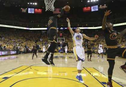LeBron James (23) blocks a shot by Warriors guard Stephen Curry in Game 5. (AP)