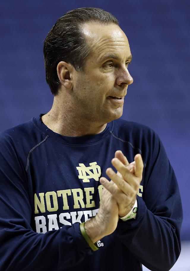 Notre Dame coach Mike Brey applauds during an NCAA college basketball practice for the Atlantic Coast Conference tournament in Greensboro, N.C., Tuesday, March 11, 2014. Notre Dame plays Wake Forest in a first round game on Wednesday. (AP Photo/Gerry Broome)