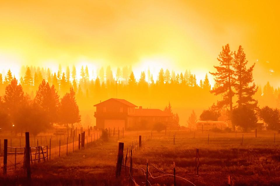 A cloud of fire and smoke fills the air over a house in Markleeville, California, on July, 16.
