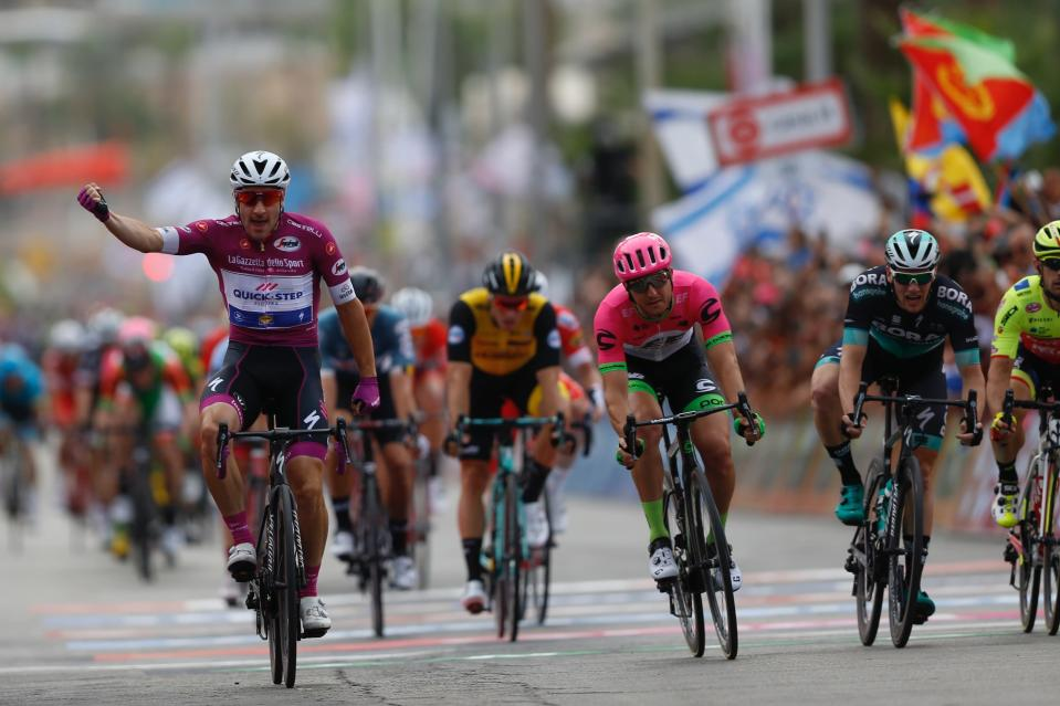 Italian cyclist Elia Viviani crosses the finish line during the third stage of 2018 Giro d'Italia, Tour of Italy cycling race, in the Red Sea city of Eilat, southern Israel, Sunday, May 6, 2018. (AP Photo/Ariel Schalit)