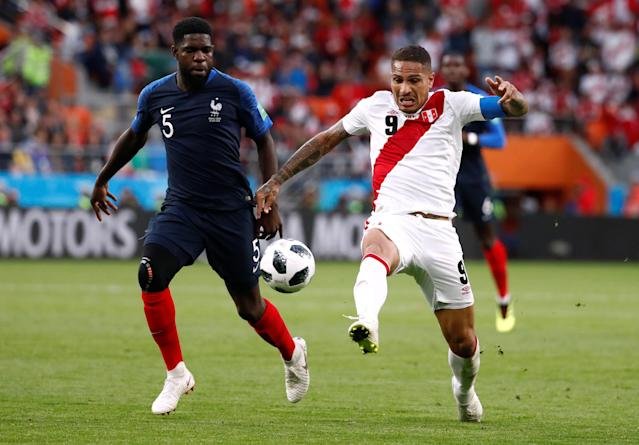 Soccer Football - World Cup - Group C - France vs Peru - Ekaterinburg Arena, Yekaterinburg, Russia - June 21, 2018 Peru's Paolo Guerrero in action with France's Samuel Umtiti REUTERS/Damir Sagolj