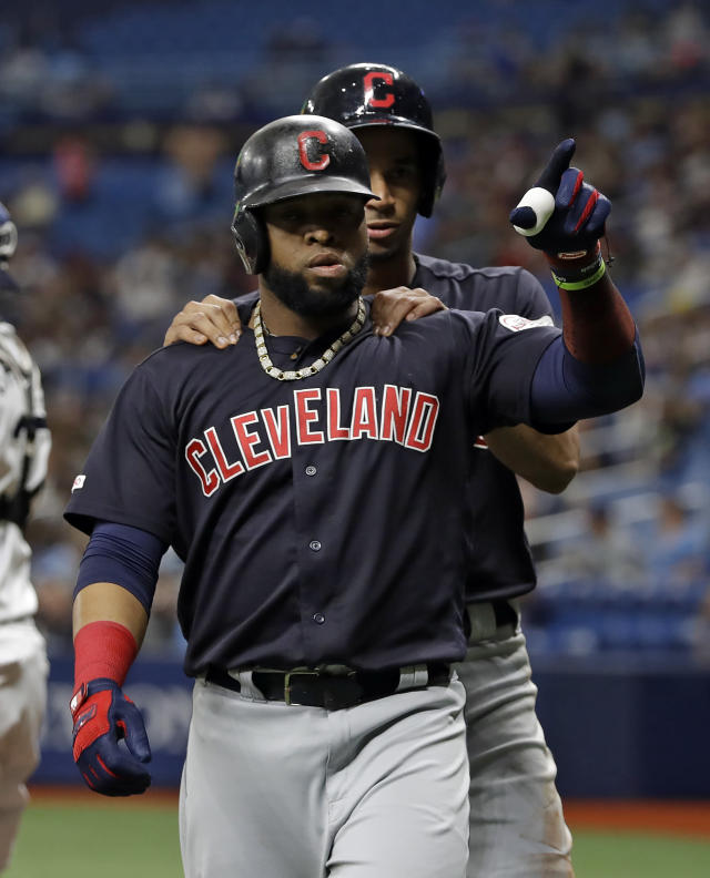 Cleveland Indians' Carlos Santana, front, celebrates with Oscar Mercado after Santana hit a two-run home run off Tampa Bay Rays' Diego Castillo during the first inning of a baseball game Saturday, Aug. 31, 2019, in St. Petersburg, Fla. (AP Photo/Chris O'Meara)