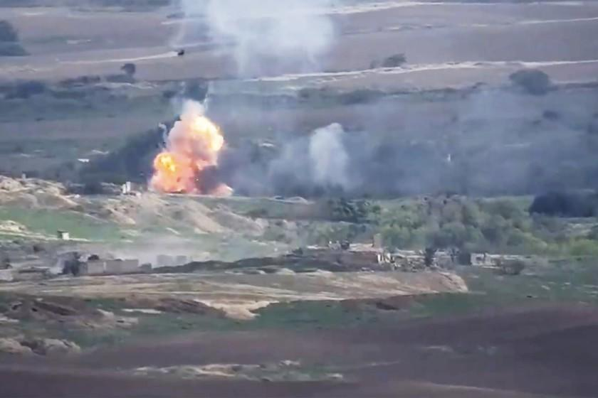 This image taken from a video released by Armenian Defense Ministry on Monday, Sept. 28, 2020 allegedly shows fighting between Armenian and Azerbaijani forces at the contact line of the self-proclaimed Republic of Nagorno-Karabakh, Azerbaijan. Armenian and Azerbaijani forces fought over the separatist region of Nagorno-Karabakh for a second day Monday, with both sides blaming each other for resuming the attacks that reportedly killed and wounded dozens as the decades-old conflict has reignited.(Armenian Defense Ministry via AP)