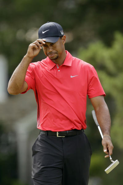Tiger Woods reacts after putting on the 15th hole during the fourth round of the U.S. Open golf tournament at Merion Golf Club, Sunday, June 16, 2013, in Ardmore, Pa. (AP Photo/Gene J. Puskar)