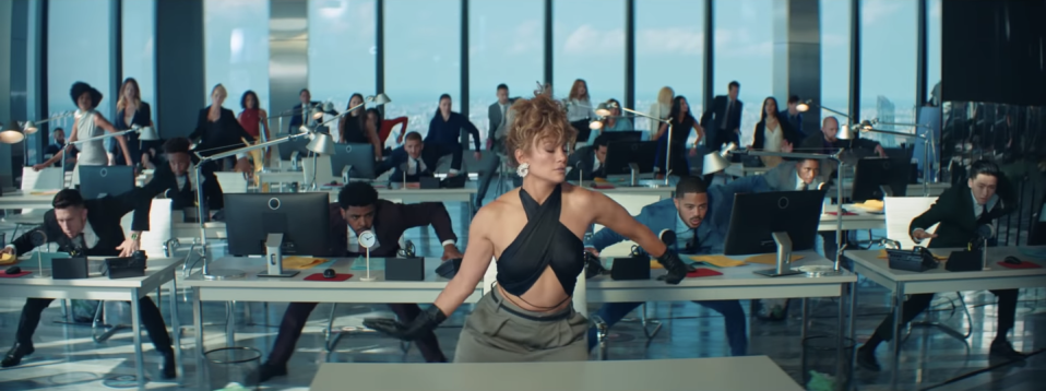 <p>J.Lo dances in a black halter top by Mirror Palais and slacks from Tibi.</p>