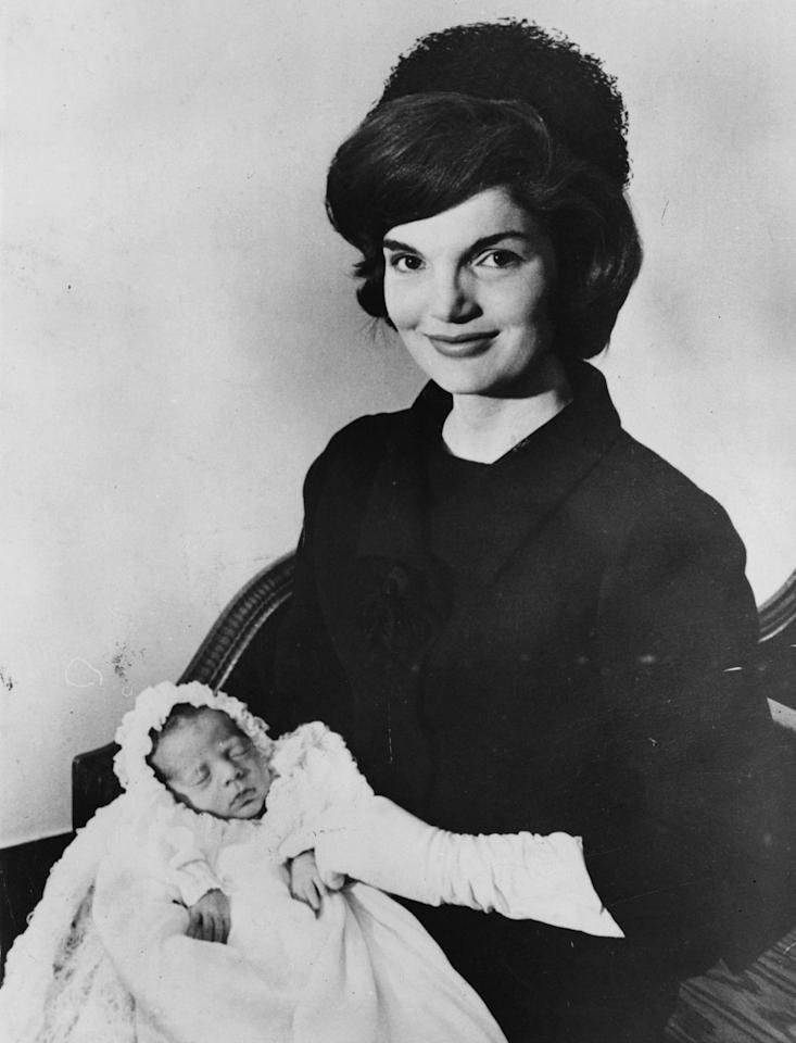 <p>Jackie Kennedy poses with her newborn son, John F. Kennedy, Jr., who arrived soon after her husband was elected president.</p>