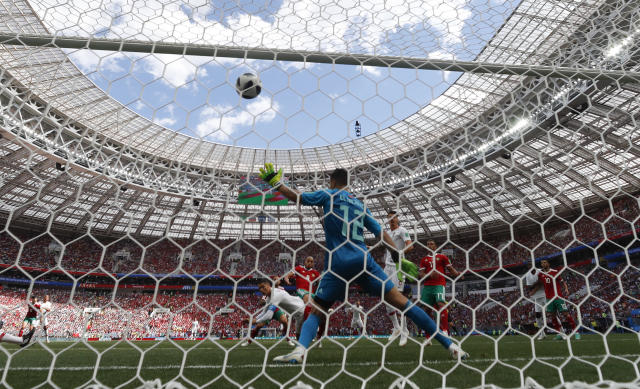 Portugal's Cristiano Ronaldo scores his side's opening goal during the group B match between Portugal and Morocco at the 2018 soccer World Cup in the Luzhniki Stadium in Moscow, Russia, Wednesday, June 20, 2018. (AP Photo/Matthias Schrader)