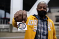 "Gary Ragland, 64, votes for the first time at State Farm Arena during early voting on Wednesday, Oct. 28, 2020, in Atlanta. ""I feel so good, its great to vote. I appreciate the help from NACA. I didn't know how to vote until I got a flyer and help from my brother,"" said Ragland. In the best of times, it's a massive logistical challenge to get millions out to vote. In 2020, the difficulty has been dramatically compounded: by fear of the coronavirus, by complications and confusion over mail-in ballots, by palpable anxiety over the bitter divisions in the country. (AP Photo/Brynn Anderson)"