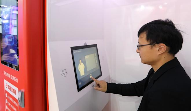 A man talks with a doctor online in an AI-powered 24/7 medical treatment platform booth run by Ping An Good Doctor, in Wuzhen, Zhejiang province. Photo: Simon Song