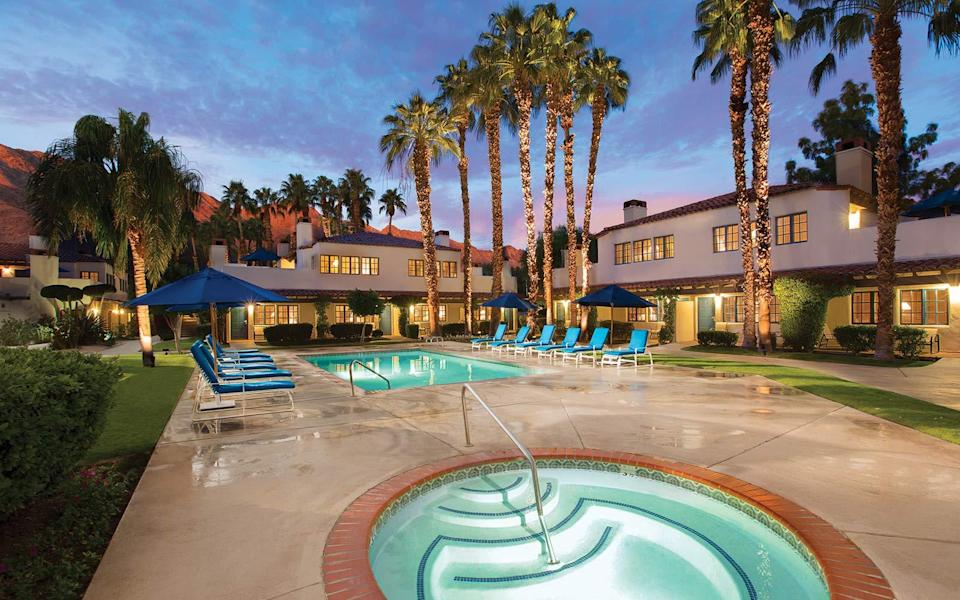 """<p>The iconic resort on the outskirts of Palm Springs is celebrating 90 years of hosting families, friends, and the Hollywood elite who return to <a rel=""""nofollow noopener"""" href=""""http://laquintaresort.com/"""" target=""""_blank"""" data-ylk=""""slk:La Quinta"""" class=""""link rapid-noclick-resp"""">La Quinta</a> year after year. Set on 45 acres of perfectly manicured gardens and towering palm trees, the resort is outlined by the Palm Desert in the distance. The hotel is made up Spanish-style casitas and whole homes that can host entire families. As far as activities are concerned, the numbers speak for themselves: La Quinta has 41 swimming pools, 23 tennis courts with both hard and clay surfaces, five golf courses, and a 23,000-square foot spa.</p>"""