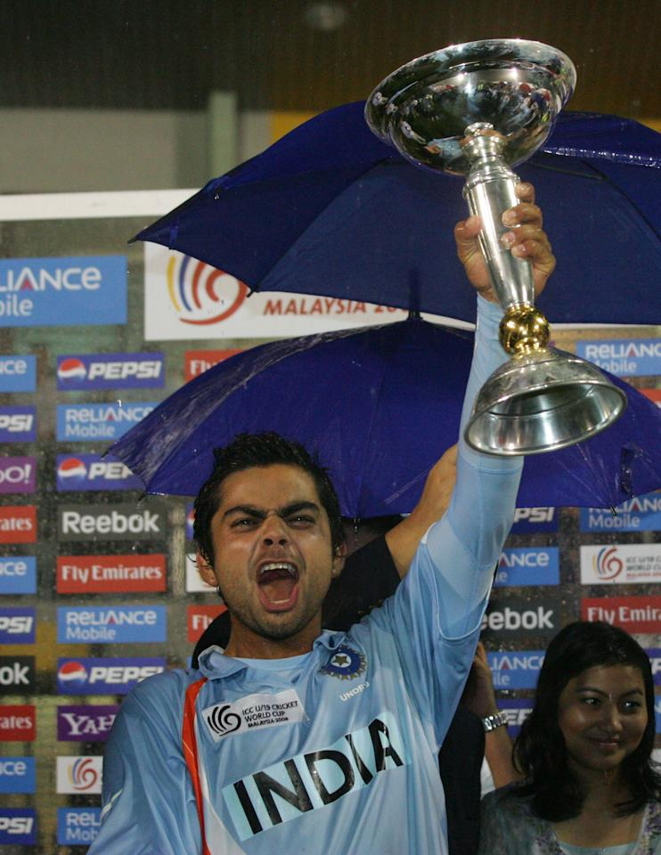 KUALA LUMPUR, MALAYSIA - MARCH 2 : Virat Kohli captain of India lifts aloft the World Cup after india defeated South Africa at the ICC U/19 Cricket World Cup Final match between India and South Africa held at the Kinrara Cricket Academy on March 2, 2008 in Kuala Lumpur, Malaysia. (Photo by Stanley Chou/Getty Images)