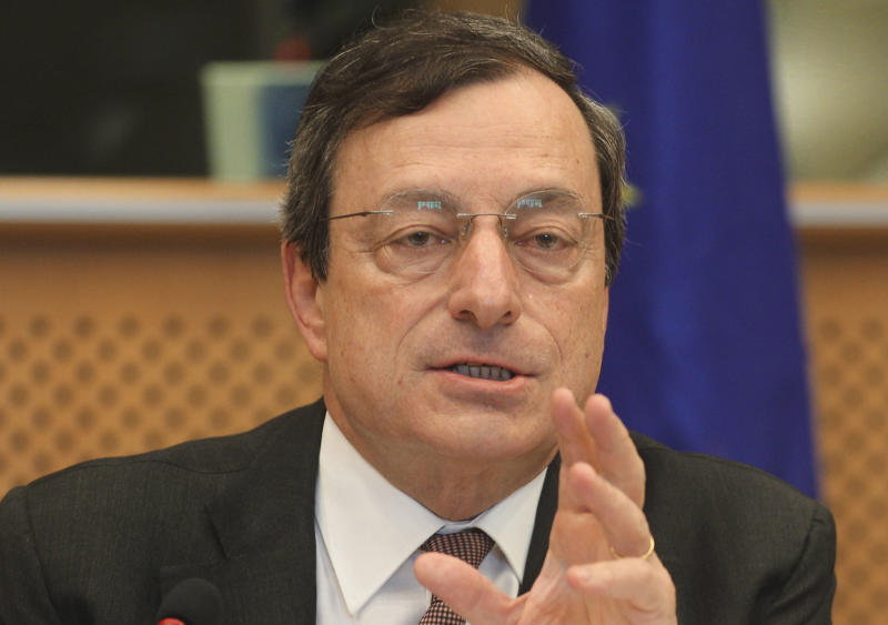 """FILE - In this May 31, 2012 file picture President of the European Central Bank Mario Draghi reports to the Economic Committee, in capacity as the head of the European Systemic Risk Board, at the European Parliament in Brussels.  European Central Bank head Mario Draghi is urging eurozone leaders to move ahead quickly and put the ECB in charge of supervising banks - a key step in overcoming the continent's crisis over too much government debt.  Draghi said the ECB should be permitted to start organizing its supervisory activities from Jan. 1, as laid out in the original proposals from the European Union's executive commission.  Draghi is pushing back against calls by German officials for delay. Germany's finance minister Wolfgang Schaueble has said that the Jan. 1 start will slip due to the need to get the complex new setup done right, and Chancellor Angela Merkel has indicated there is no hurry on the proposals. Draghi told members of the European Parliament's monetary committee that the single banking supervisor, combined with later measures such as a common bailout fund and shared deposit insurance for people's savings, were """"three pillars that will restore confidence"""" in the shaken eurozone. Together, the package is dubbed """"banking union."""" (AP Photo/Yves Logghe, File)"""