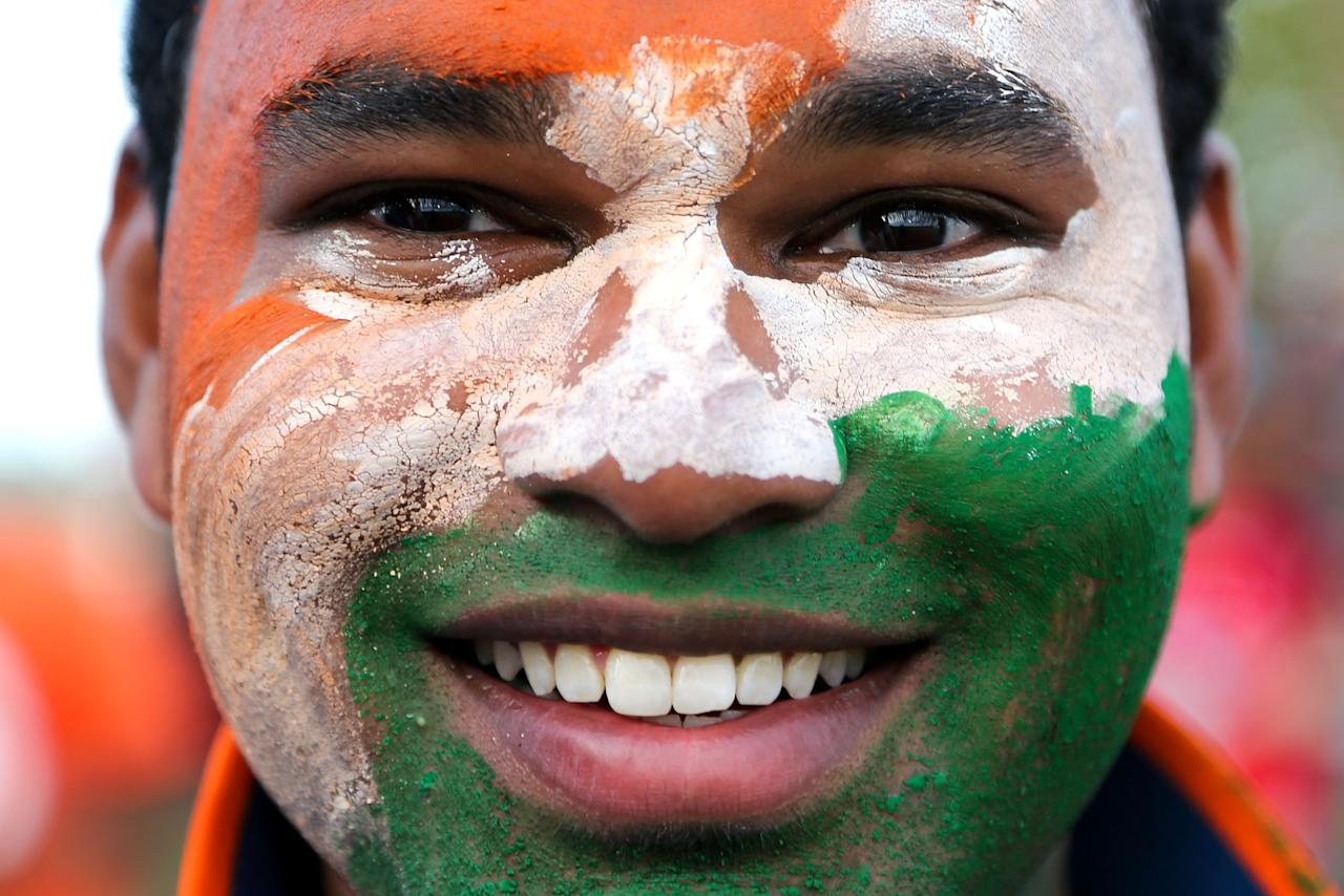 NAPIER, NEW ZEALAND - JANUARY 19:  An Indian fan covered in face paint shows his support during the first One Day International match between New Zealand and India at McLean Park on January 19, 2014 in Napier, New Zealand.  (Photo by Hagen Hopkins/Getty Images)
