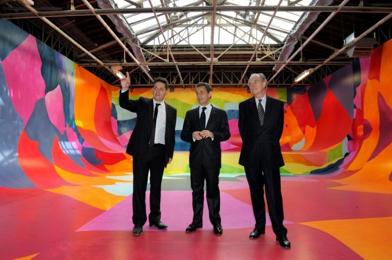 Former French president Nicolas Sarkozy (c) at the Palais de Tokyo in April 2012 after it was renovated by Anne Lacaton and Jean-Philippe Vassal