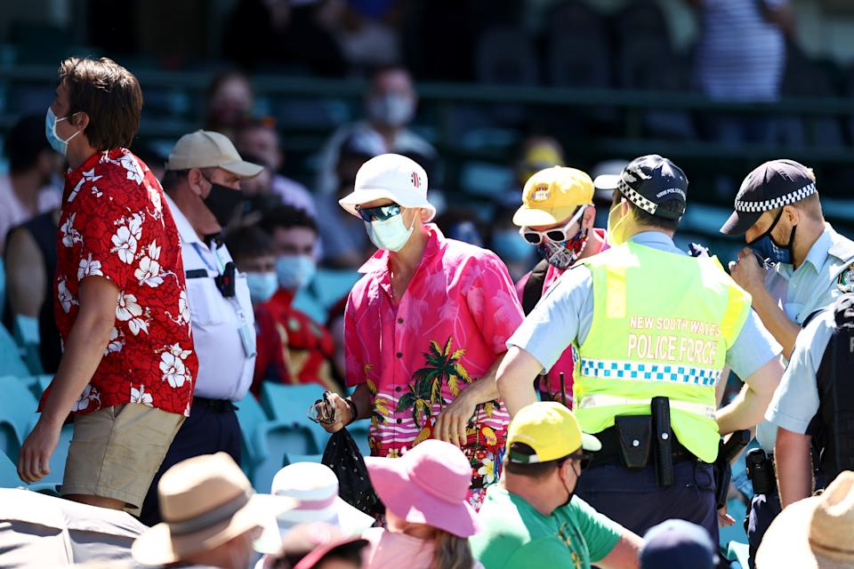 SYDNEY, AUSTRALIA - JANUARY 10: Police speak to spectators following a complaint from Mohammed Siraj of India that stopped play during day four of the Third Test match in the series between Australia and India at Sydney Cricket Ground on January 10, 2021 in Sydney, Australia. (Photo by Cameron Spencer/Getty Images)