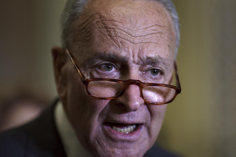 FILE - In this Sept. 21, 2021, file photo Senate Majority Leader Chuck Schumer, D-N.Y., criticizes Republicans as he speaks to reporters after a weekly policy meeting, at the Capitol in Washington. (AP Photo/J. Scott Applewhite, File)