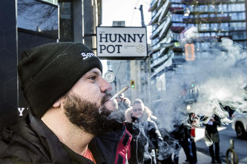 TORONTO, ON - APRIL 1: Cannaibis educator Jonathan Hirsh smokes a joint he purchased outside the Hunny Pot Cannabis Co. store at 202 Queen St. W. (Andrew Francis Wallace/Toronto Star via Getty Images)