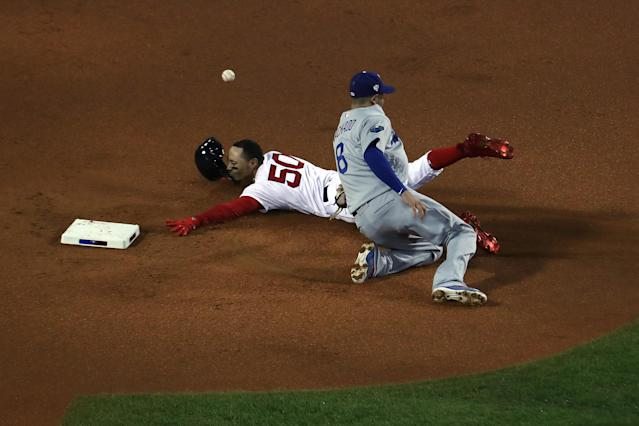 Mookie Betts stole a base in the first inning of Game 1 of the World Series on Tuesday night, earning free tacos for all of America. (Getty Images)