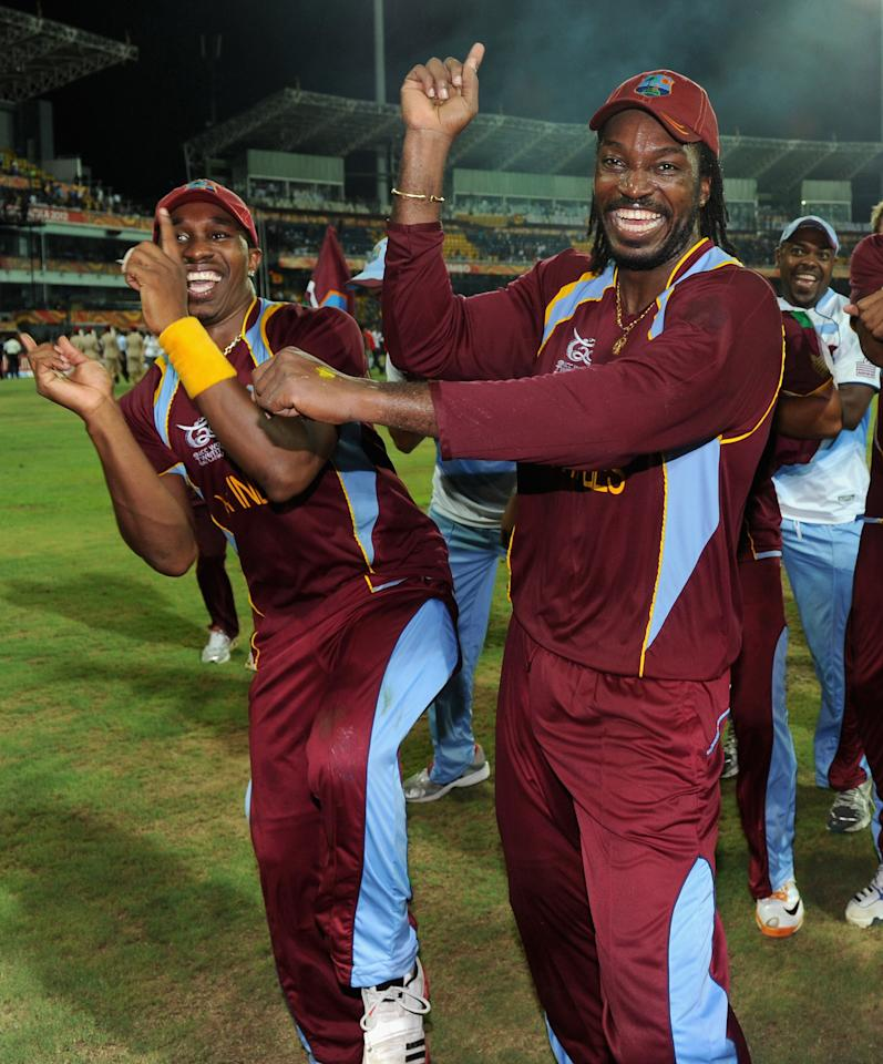 COLOMBO, SRI LANKA - OCTOBER 07:  Dwayne Bravo and Chris Gayle of the West Indies celebrate winning the ICC World Twenty20 2012 Final between Sri Lanka and the West Indies at R. Premadasa Stadium on October 7, 2012 in Colombo, Sri Lanka.  (Photo by Gareth Copley/Getty Images)