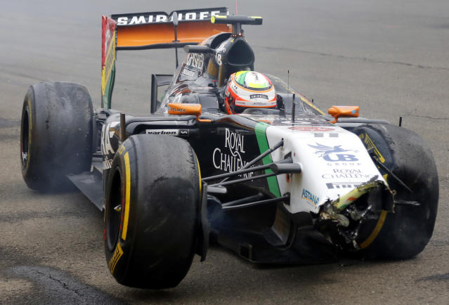 Force India's Mexican driver Sergio Perez sits in his wrecked car during the Hungarian Formula One Grand Prix at the Hungaroring circuit in Budapest on July 27, 2014 (AFP Photo/Darko Bandic)
