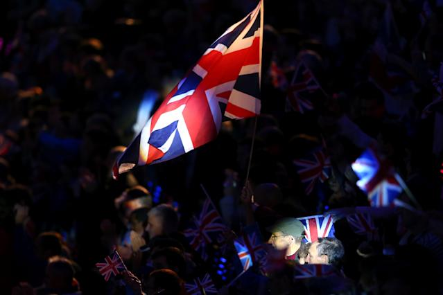 LONDON, ENGLAND - AUGUST 29: A specator waves the Union flag during the Opening Ceremony of the London 2012 Paralympics at the Olympic Stadium on August 29, 2012 in London, England. (Photo by Mike Ehrmann/Getty Images)