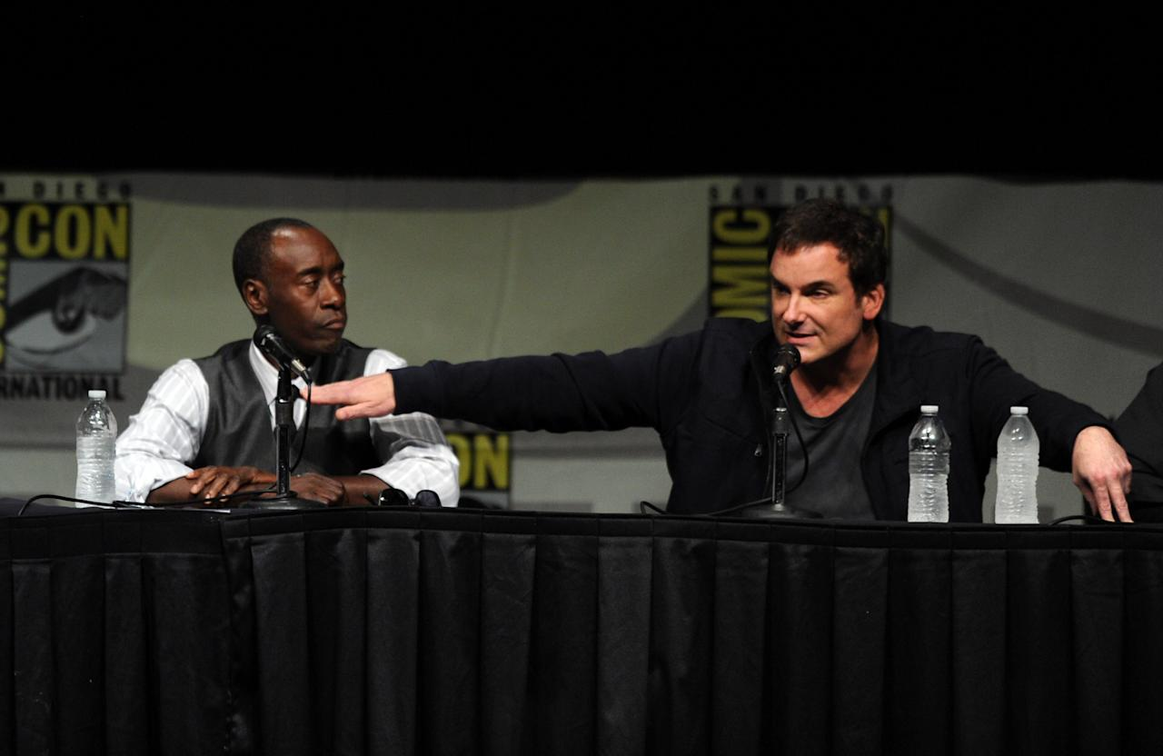 """SAN DIEGO, CA - JULY 14:  Actor Don Cheadle (L) and director Shane Black speak at Marvel Studios """"Iron Man 3"""" panel during Comic-Con International 2012 at San Diego Convention Center on July 14, 2012 in San Diego, California.  (Photo by Kevin Winter/Getty Images)"""