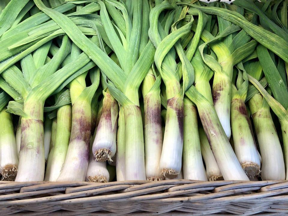 """<p>Forget about white and red onions for a minute—spring is leek season, and that's a good thing! Leeks are incredibly nutritious and are a nice addition to almost any meal. <a href=""""https://fadfreenutrition.nutricionalgrano.com/"""" rel=""""nofollow noopener"""" target=""""_blank"""" data-ylk=""""slk:Melissa Nieves"""" class=""""link rapid-noclick-resp"""">Melissa Nieves</a>, registered nutritionist dietitian, told Redbook, """"Just like garlic and onions, leeks have the same antioxidant properties as the rest of the allium family. These compounds are great for promoting and protecting heart health. For example, quercetin, one of its antioxidants, has anti-inflammatory properties that may help control high blood pressure and lower cholesterol levels as well."""" </p>"""
