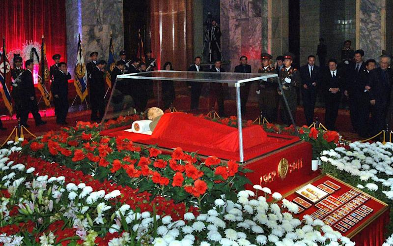 The body of North Korean leader Kim Jong-il lies in state at the Kumsusan Memorial Palace in Pyongyang shortly after his death in 2011 - REUTERS