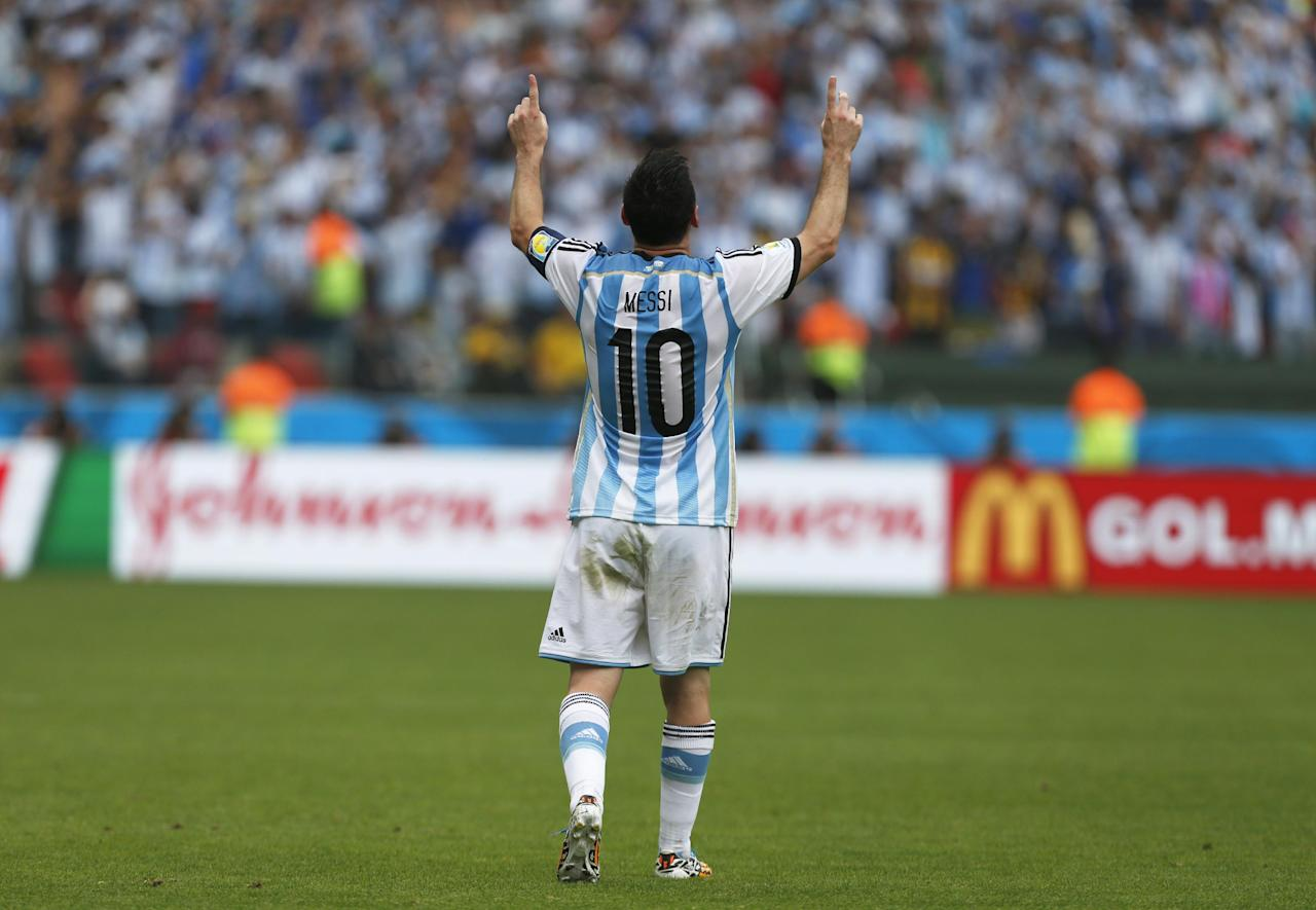 Argentina's Lionel Messi celebrates after scoring his side's second goal during the group F World Cup soccer match against Nigeria at the Estadio Beira-Rio in Porto Alegre, Brazil, Wednesday, June 25, 2014. (AP Photo/Jon Super)