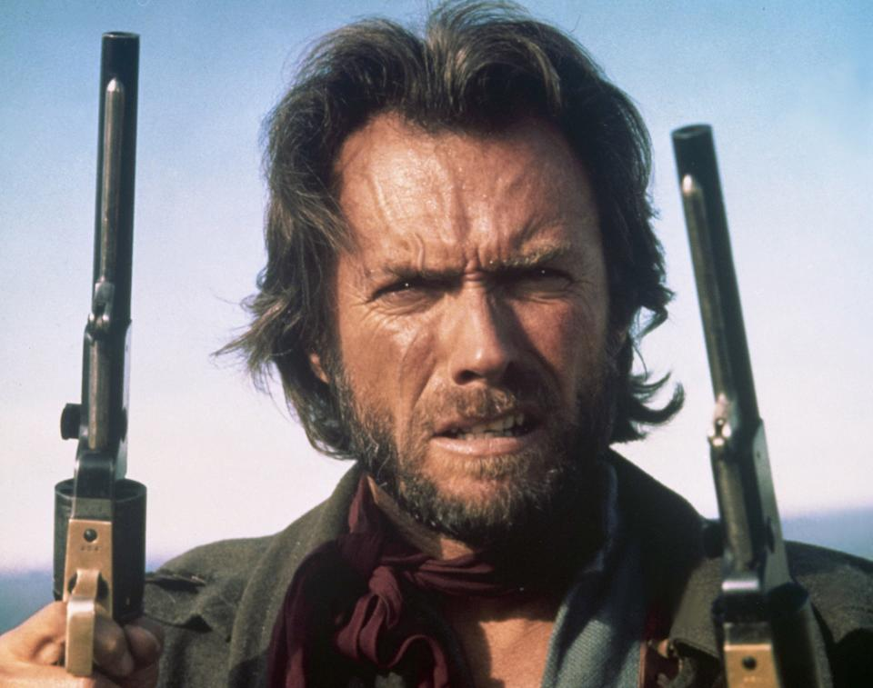 American actor and director Clint Eastwood on the set of his movie The Outlaw Josey Wales. (Photo by Sunset Boulevard/Corbis via Getty Images)