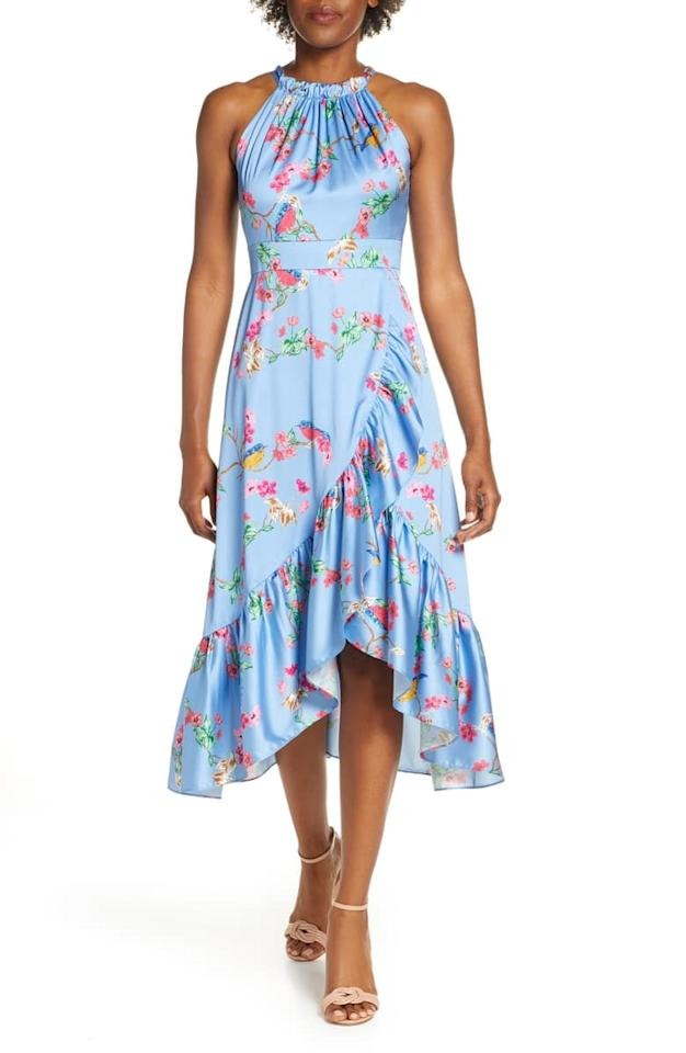 """<p>The print on this <a href=""""https://www.popsugar.com/buy/Eliza-J-HighLow-Midi-Sundress-490946?p_name=Eliza%20J%20High%2FLow%20Midi%20Sundress&retailer=shop.nordstrom.com&pid=490946&price=158&evar1=fab%3Aus&evar9=46067033&evar98=https%3A%2F%2Fwww.popsugar.com%2Ffashion%2Fphoto-gallery%2F46067033%2Fimage%2F46619439%2FEliza-J-HighLow-Midi-Sundress&list1=fall%20fashion%2Cdresses%2Cfall%2Cspring%2Csummer%2Cpetites%2Cshoppping%2Cspring%20fashion%2Csummer%20fashion%2Cwedding%20guest%20dresses&prop13=api&pdata=1"""" rel=""""nofollow"""" data-shoppable-link=""""1"""" target=""""_blank"""" class=""""ga-track"""" data-ga-category=""""Related"""" data-ga-label=""""https://shop.nordstrom.com/s/eliza-j-high-low-midi-sundress/5282984?origin=keywordsearch-personalizedsort&amp;breadcrumb=Home%2FAll%20Results&amp;color=sky"""" data-ga-action=""""In-Line Links"""">Eliza J High/Low Midi Sundress</a> ($158) is beautiful.</p>"""