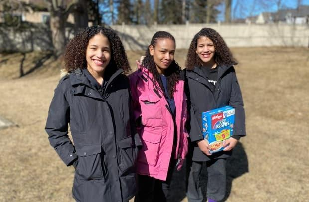 SolangeScott, middle, standing with her 13-year-old daughters Jordynn, left, and Jurnee. Scott is now asking for a public apology from Walmart after she says employees racially profiled her family, and accused her daughter of theft.  (Paul Borkwood/CBC - image credit)