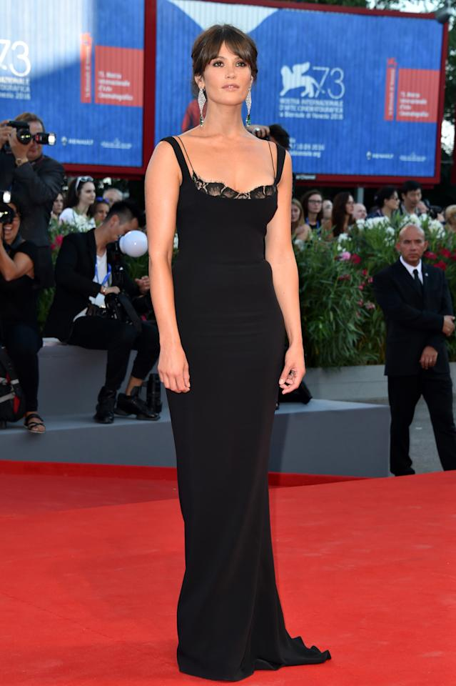 <p>The British actress slipped into a form-fitting black column dress for the 'La La Land' premiere. A pair of statement Chopard earrings enhanced the look. <i>[Photo: Getty]</i></p>