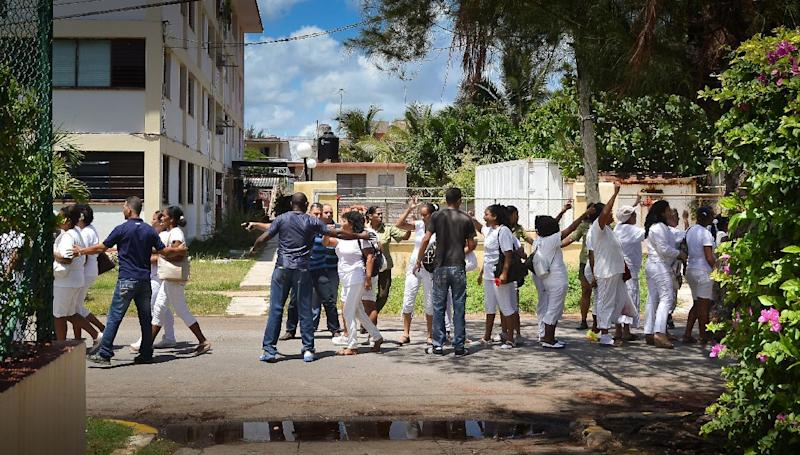"""Members of the Ladies in White opposition movement are arrested in Havana on July 13, 2014 during a peaceful march to commemorate the 20th anniversary of the sinking of the tugboat """"13 de Marzo"""" in which 37 Cubans died while trying to reach the US"""
