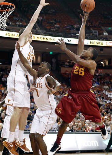 Iowa State's Tyrus McGee (23) shoot over Texas defenders Clint Chapman (53) and Sheldon McClellan (1) during the first half of an NCAA college basketball game, Tuesday, Jan. 24, 2012, in Austin, Texas. (AP Photo/Eric Gay)
