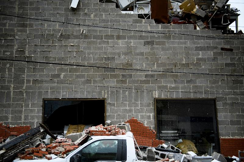 A truck is seen below a partially collapsed wall damaged by Hurricane Michael in Panama City, Florida (AFP Photo/Brendan Smialowski)