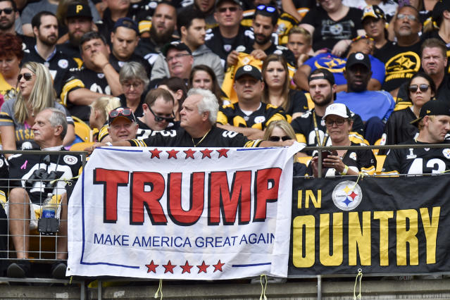 A Pittsburgh Steelers fan holds a Trump sign at a game on Oct. 8, 2017. (AP)