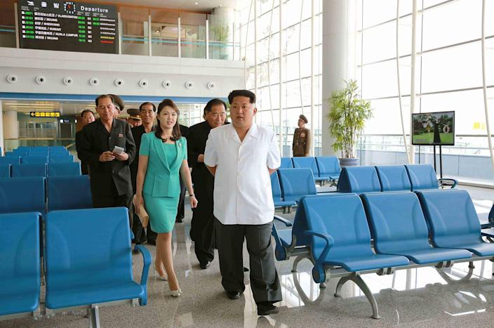 This picture taken and released from North Korea's official Korean Central News Agency on June 25, 2015 shows North Korean leader Kim Jong-un and wife Ri Sol-Ju, inspecting the new terminal at Pyongyang International Airport.