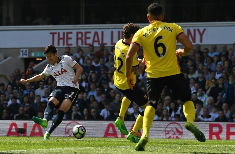 Tottenham Hotspur's Son Heung-Min (L) scores his team's fourth, and his second goal during their match against Watford at White Hart Lane in London, on April 8, 2017