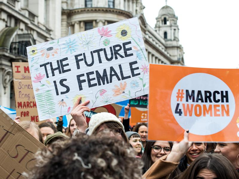 Placards are displayed during the March4Women on 4 March in London: Getty