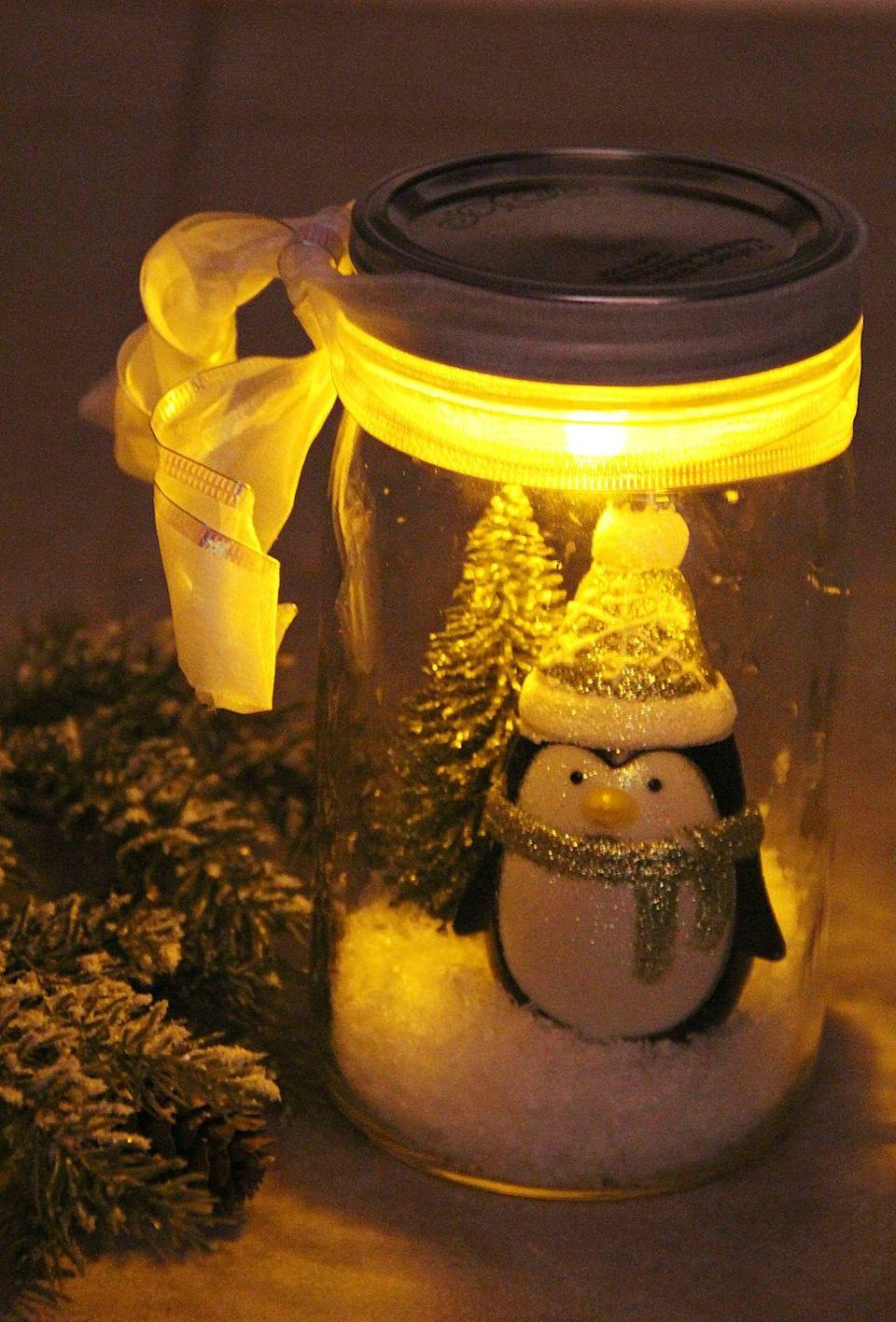 """<p>These tiny jars can double as the cutest Christmas nightlight for your little ones. </p><p><strong>Get the tutorial at <a href=""""http://bitzngiggles.com/2013/11/illuminated-snow-scene-in-a-jar.html"""" rel=""""nofollow noopener"""" target=""""_blank"""" data-ylk=""""slk:Bitz & Giggles"""" class=""""link rapid-noclick-resp"""">Bitz & Giggles</a>.</strong></p><p><a class=""""link rapid-noclick-resp"""" href=""""https://www.amazon.com/FloraCraft-4-Liters-Plastic-Snow/dp/B000XZY0OY/?tag=syn-yahoo-20&ascsubtag=%5Bartid%7C10050.g.2132%5Bsrc%7Cyahoo-us"""" rel=""""nofollow noopener"""" target=""""_blank"""" data-ylk=""""slk:SHOP ARTIFICIAL SNOW"""">SHOP ARTIFICIAL SNOW</a></p>"""