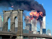 <p>The moment the second tower of the World Trade Center explodes into flames at 9.03 in the morning after being hit by one of the hijacked planes. Both towers of the complex were to collapse. (Reuters)</p>