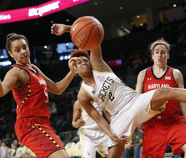 Georgia Tech's Aaliyah Whiteside (2) and Maryland center Malina Howard (5) battle for a rebound as Maryland guard Katie Rutan, looks on at right, in the second half of an NCAA women's college basketball game, Sunday, Feb. 23, 2014, in Atlanta. (AP Photo/John Bazemore)